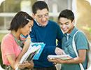 A teacher talking to a boy and a girl.