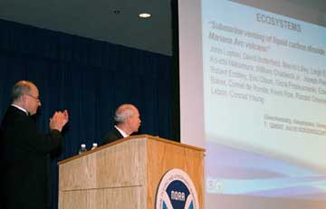 NOAA Research director Richard Spinrad and deputy director Sandy MacDonald acknowledge     the award recipients during a webcast.