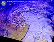 The satellite image shows a large winter storm covering a large part of the northeastern US