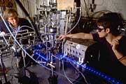 Technicians adjust instruments used for measuring air quality