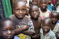Local children are pictured during a site visit to Reach-Out Mbuya Kinawataka Clinic. Photo by Arne Clausen.