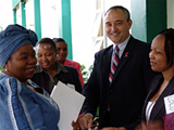 Minister of Health (Prof.) Sheila Tlou greets U.S. Embassy Deputy Chief of Mission, Philip Drouin, and members of BOMWA outside of the Maharaja Conference Centre in Gaborone before the seminar.