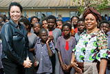 """U.S. Ambassador Carmen Martinez and First Lady Maureen Mwanawasa are pictured with students from the Chawama Basic School where the HIV/AIDS prevention campaign, """"Real Man, Real Woman,"""" was launched. Photo by Zambia In-Country Team"""
