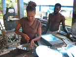 Samantha Brown obtained a small loan to expand her and her husband's business producing and selling tin products.
