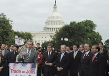 Gutierrez, surrounded by officials with U.S. Capitol in background. Click for larger image.