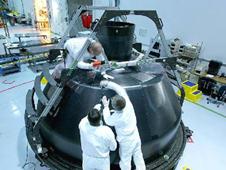 Technicians prepare the Composite Crew Module for autoclave curing.