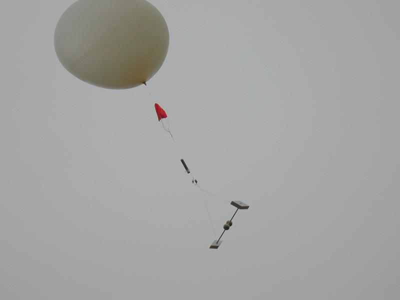 Balloon flight following the launch. The instrument train consists (top to bottom) of a parachute, a GPS radiosonde (the cylinder), and an electric field meter for determining the electrical structure of storms.