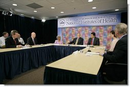 President George W. Bush speaks during a roundtable on cancer prevention at the National Institutes of Health in Bethesda, Md., Wednesday, Jan. 17, 2007. Participants include, from left: Secretary of Health and Human Services Mike Leavitt, NIH Director Dr. John Niederhuber, M.D., Dr. Grace Butler, PhD., NIH Director Dr. Elias Zerhouni, Becky Fisher, and Dr. Francis Collins, M.D., Ph.D.  White House photo by Eric Draper