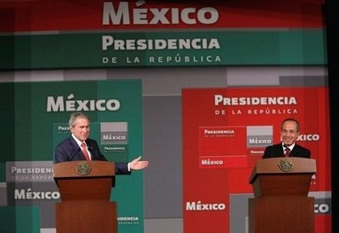 President George W. Bush and Mexico's President Felipe Calderon appear together Wednesday, March 14, 2007 in Merida, Mexico, during a joint news conference. Mexico is the last stop on President Bush's five country visit to Latin America. White House photo by Paul Morse