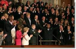 """Wesley Autrey receives a standing ovation as President Bush recognizes him during his State of the Union Address at the U.S. Capitol Tuesday evening, Jan. 23, 2007. """"Three weeks ago, Wesley Autrey was waiting at a Harlem subway station with his two little girls, when he saw a man fall into the path of a train,"""" said President Bush. """"With seconds to act, Wesley jumped onto the tracks, pulled the man into the space between the rails, and held him as the train passed right above their heads. He insists he's not a hero. He says: 'We got guys and girls overseas dying for us to have our freedoms. We have got to show each other some love.' There is something wonderful about a country that produces a brave and humble man like Wesley Autrey."""" White House photo by Shealah Craighead"""