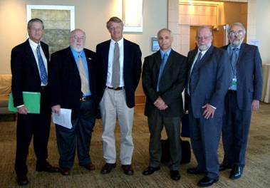 Photo of meeting attendees: Steve Higgins of the Broward County Environmental Protection Department, Mayor Harry Simmons of Caswell Beach, NC, Tony Pratt of the Delaware Department of Natural Resources and Environmental Control, Peppino Persio and Greg Malon of the U.S. Army Corps of Engineers, and John Fay of the U.S. Fish and Wildlife Service.