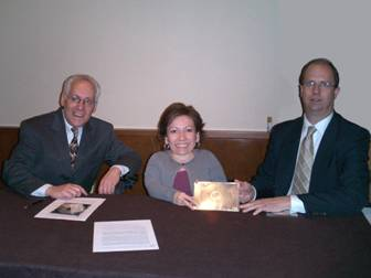 Photo of TEITAC co-chairs Jim Tobias and Mike Paciello presenting the committee's report to Board chair Tricia Mason