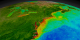 This animation begins with a wide shot of the United States and zooms down to the Northeastern seaboard of the United States while cycling through nearly ten years of SeaWiFS biosphere data.