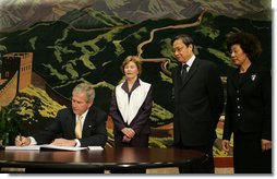 President George W. Bush signs his condolences for the victims of China's May 12 earthquake as he and Mrs. Laura Bush visit the Embassy of the People's Republic of China Tuesday, May 20, 2008, in Washington, D.C. With them are China's Ambassador to the United States Wenzhong Zhou and his spouse, Shumin Xie. White House photo by Joyce N. Boghosian
