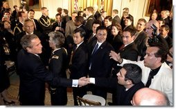 President George W. Bush greets enthusiastic audience members after discussing his immigration policy in the East Room Wednesday, Jan. 7, 2004.  White House photo by Paul Morse