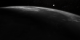 The LRO spacecraft traverses from darkness into daylight.