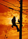 Worker on electrical pole