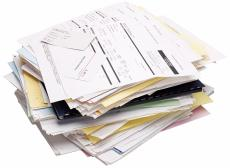 Photograph of medical bills and receipts