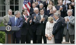 President George W. Bush, joined by Senate and House members, welcomes John and Reve Walsh prior to signing H.R. 4472, the Adam Walsh Child Protection and Safety Act of 2006 at a ceremony Thursday, July 27, 2006, in the Rose Garden at the White House. The bill is named for the Walsh's six-year-old son Adam Walsh who was abducted and killed 25 years ago. White House photo by Paul Morse