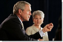 President George W. Bush addresses his remarks to an audience during his participation at a panel discussion Tuesday, Aug. 22, 2006, at the Minneapolis Marriott Southwest in Minnetonka, Minn., offering perspectives on efforts to enhance health care transparency and move towards a value-based health care competition. White House photo by Paul Morse