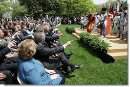 The audience takes part in a performance by the Kankouran West African Dance Company during a ceremony marking Malaria Awareness Day Wednesday, April 25, 2007, in the Rose Garden. White House photo by Eric Draper