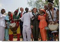 """President George W. Bush and Mrs. Laura Bush stands with the Kankouran West African Dance Company after delivering remarks during a ceremony marking Malaria Awareness Day Wednesday, April 25, 2007, in the Rose Garden. """"The American people, through their government, are working to end this epidemic,""""said President Bush. """"In 2005, President Bush announced the President's Malaria Initiative -- a five-year, $1.2 billion program to combat malaria in the hardest-hit African nations.""""  White House photo by Eric Draper"""