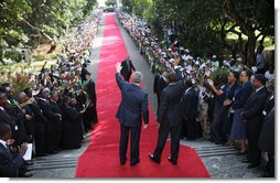 President George W. Bush and President Jakaya Kikwete of Tanzania, wave to the ceremonial arrival cordon as they reach the steps of the State House in Dar es Salaam Sunday, Feb. 17, 2008. White House photo by Eric Draper