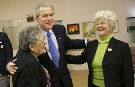 President George W. Bush greets Millie Martinez, right, and Ida Gonzalez at Bear Canyon Senior Center in Albuquerque, Tuesday, March 22, 2005, as he took his Conversation for Strengthening Social Security into New Mexico. The president reassured the approximately 30 breakfast guests that those born before 1950 will be unaffected by proposed reforms to the program.  White House photo by Eric Draper.