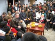 Secretary Leavitt meets with villagers in Yujian Village, Sichuan.