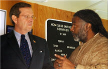 Secretary Leavitt speaks with the Christ House Director of Outreach