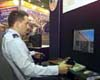 2nd Lt. Ferguson works controls of a fighter simulator