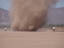 researchers chase a large dust devil on June 8