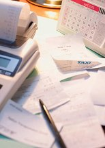Picture of pen, calculator and papers