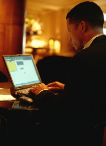 Image of a man working with a laptop