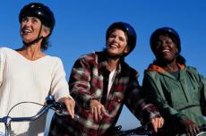 Photograph of three women in bike helmets