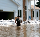 man standing in flood waters