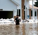 man standing in flood waters