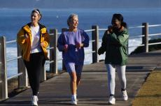 Photograph of three women walking