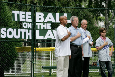 President George W. Bush is joined during the playing of the National Anthem by Roberto Clemente Jr., left, son of Hall of Famer Roberto Clemente; Angel Macias, who in 1957 became the only player to pitch a perfect game in Little League World Series history, and actor Jake T. Austin, right, who will portray Macias in an upcoming film about that game, seen together Monday, June 30, 2008, at Tee Ball on the South Lawn at the White House.