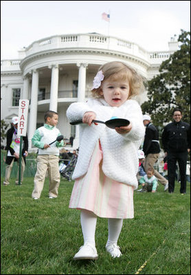 A young child carefully balances her Easter Egg on a spoon Monday, March 24, 2008 on the South Lawn of the White House, during the 2008 White House Easter Egg Roll.