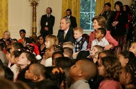 President George W. Bush and Laura Bush sit with children.