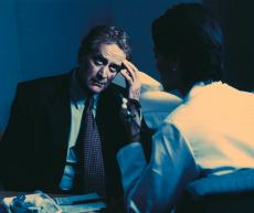 Photograph of a man talking to his doctor