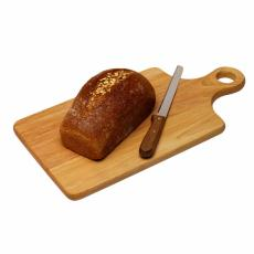 Photograph of a loaf of wheat bread on a cutting board