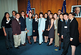 Secretary Chao, center, surrounded by DOL Summer 2002 interns.