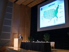 NASA CIO, Jonathan Pettus, speaking to a crowd about the NASA IT environment.