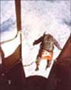 Captain Kittinger steps from a balloon-supported gondola at 102,800 feet in his high-altitude jump from the Excelsior