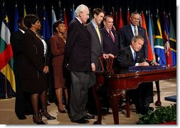President George W. Bush signs H.R. 1298, the United States Leadership Against HIV/AIDS, Tuberculosis, and Malaria Act of 2003, at the State Department in Washington, D.C., Tuesday, May 27, 2003. The legislation commits $15 billion to fight AIDS abroad.  White House photo by Tina Hager