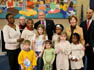 President George W. Bush and Laura Bush are joined by Washington, D.C. Mayor Adrian Fenty, right, and Ginnie Cooper,Chief Librarian for the Washington, D.C. libraries, left, posing for photos with children and staff at a reading class commemorating Martin Luther King Day Monday, Jan. 21, 2008, at the Martin Luther King Jr. Memorial Library.
