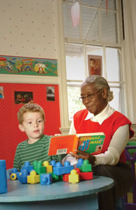 SCSEP participant contributes to the reading experience of daycare children.  Copyright Mark DeLong 2005