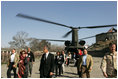 Laura Bush and U.S. Ambassador to Afghanistan Zalmay Khalilzad arrive at the Presidential Palace in Kabul, Afghanistan, Wednesday, March 30, 2005.